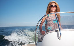Woman  in Dress Driving A Speedboat Stock Images