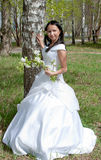 Woman in the dress of fiancee in summer in a park Royalty Free Stock Photos