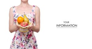 Woman in a dress floral print in the hands basket fruits apple pear orange pattern stock photo