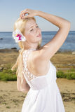 Woman in dress with flower in hairs Stock Photography