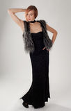 Woman in Dress and Fur Vest Royalty Free Stock Photography