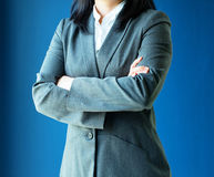 Woman dress grey suit for working. With blue background stock image