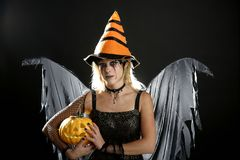 Woman dress for halloween and pumpkin stock images