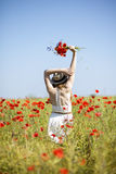 Woman at dress and hat with bouquet Royalty Free Stock Photography