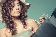Woman in dress and hat hold shopping bag Royalty Free Stock Photo