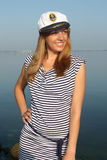 Woman in dress and hat near the sea Royalty Free Stock Photography
