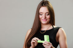 Woman in dress holding green gift box Royalty Free Stock Photos