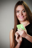 Woman in dress holding green gift box Stock Photography