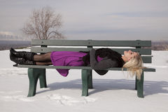Woman dress lay on bench snow Stock Photo