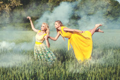 Woman in a dress levitates over the field. royalty free stock photo