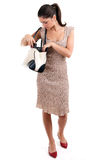 Woman in dress looking to bag Stock Photos