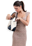 Woman in dress looking to bag Stock Photography
