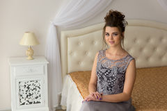 Woman in dress, luxury bedroom on background Royalty Free Stock Photo