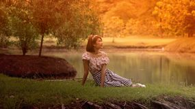 Woman in Dress Lying on Grass Royalty Free Stock Photos