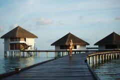 Woman in a dress on maldivian sunset Stock Photos