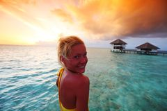Woman in a dress on maldivian sunset Stock Photos