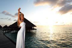Woman in a dress on maldivian sunset Stock Photography