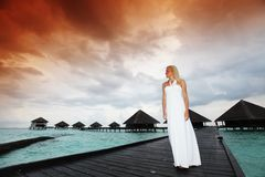 Woman in a dress on maldivian sunset Royalty Free Stock Photography