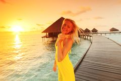 Woman in a dress on maldivian sunset Royalty Free Stock Photo