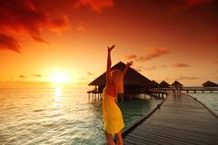 Woman in a dress on maldivian sunset Royalty Free Stock Photos