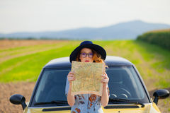Woman in dress with map near a yellow Royalty Free Stock Photography