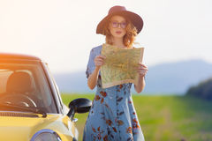 Woman in dress with map near a yellow Royalty Free Stock Images
