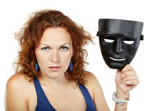 Woman in dress with mask in hand Royalty Free Stock Photos