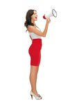 Woman in a dress with megaphone Royalty Free Stock Photography