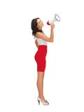 Woman in a dress with megaphone Stock Images