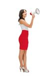 Woman in a dress with megaphone Stock Image