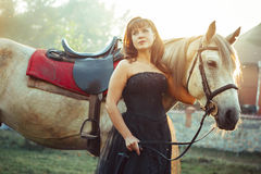 Woman in dress next to the horse. Portrait attractive woman full length next horse Royalty Free Stock Photo