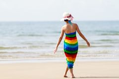 Woman in a dress on the ocean coast Stock Photography