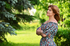 Woman in a dress with open shoulders is about Birch Stock Photos