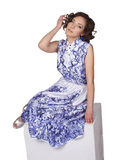 Woman in a dress with a pattern gzhel Stock Image