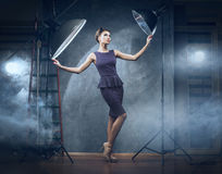A woman in a dress posing in a studio Royalty Free Stock Photos