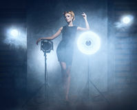 A woman in a dress posing in a studio Stock Images