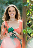 Woman in dress with pruner Royalty Free Stock Photo