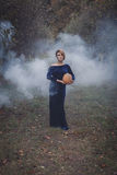 Woman in dress with pumpkin Royalty Free Stock Photography