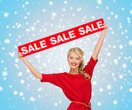 Woman in dress with red sale sign Royalty Free Stock Photos