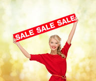 Woman in dress with red sale sign Stock Photography