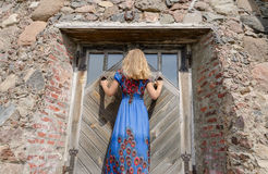 Woman with dress at retro old manor door entrance Royalty Free Stock Images
