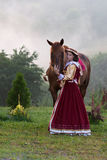Woman in dress royal baroque riding Stock Photography