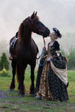 Woman in dress royal baroque riding Stock Photo