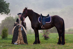 Woman in dress royal baroque riding Royalty Free Stock Images