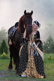 Woman in dress royal baroque riding Stock Image
