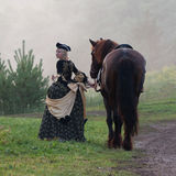 Woman in dress royal baroque riding Royalty Free Stock Photo