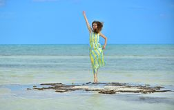 Woman in dress  on a sandbank in the ocean. Adorable young girl on sandy beach .  Young lady posing on beach. Outdoor relax leisure concept. Cuba. Caya Coco Stock Photo