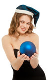 Woman in dress smiling with blue new year ball Stock Photography