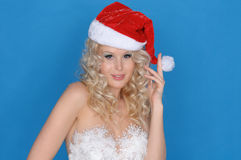 Woman in dress of snowflakes and Christmas hat Stock Photos