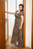 Woman in dress standing in domestic room Stock Photos